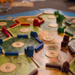 Playing the Settlers of Catan Without Umbrellas
