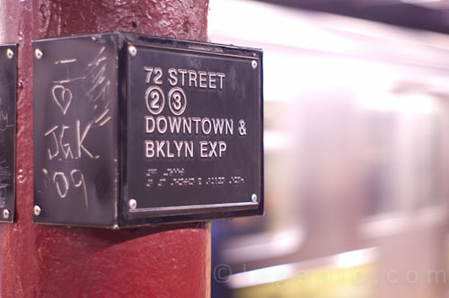 Shot of a train in NYC with a subway sign
