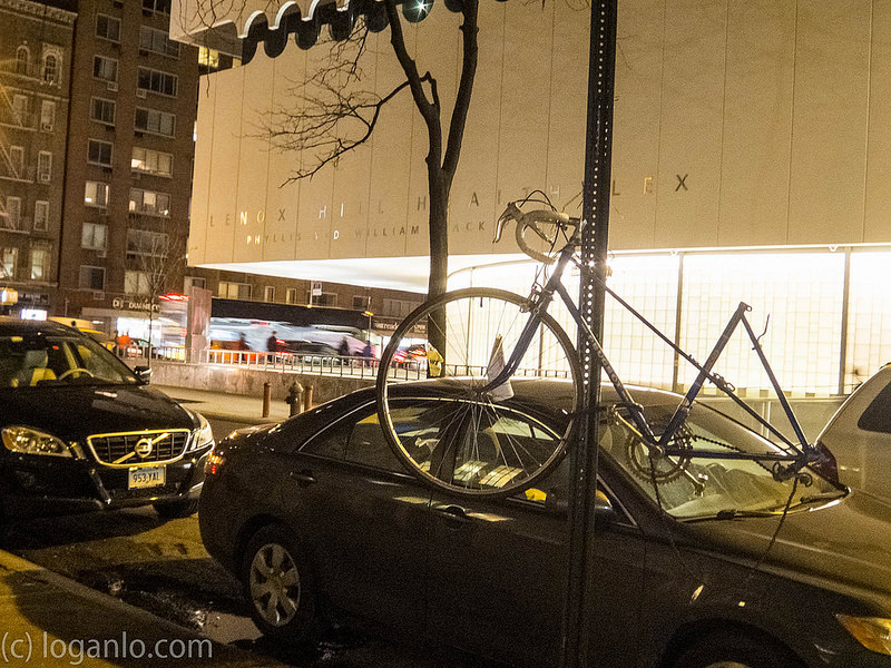 Bicycle hanging on a pole in NYC